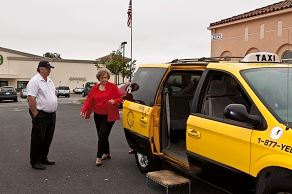 Picture of woman walking into a taxi cab for the Laguna Hills Dial A Taxi Program