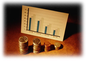 Bar chart with 4 sets of 3 vertical bars on the chart and 4 stacks of coins in front of the chart